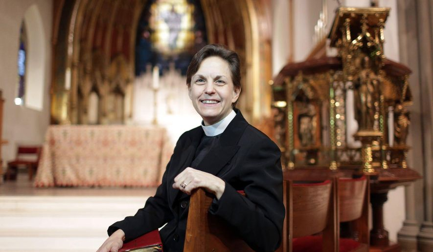 ADVANCE FOR USE SATURDAY, JAN. 30 - In this photo taken Jan. 13, 2016, Rev. Rebecca Barnes poses for a photo at at St. Luke's Episcopal Church in West Pittston, Pa. Until her 30s, she answered with a song. Today, she answers with a sermon. (Jake Danna Stevens/The Times & Tribune via AP) WILKES BARRE TIMES-LEADER OUT; MANDATORY CREDIT