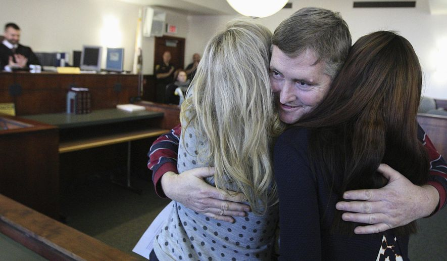 In this Jan. 12, 2016 photo, Jeff Lingle thanks Heritage Behavioral Health Center therapist, Amy Gillen, left, and case manager Jasmine Ryan after graduating from Mental Health Court at the Macon County Circuit Court facility in Decatur, Ill. The court helps people turn their lives around. There have been 19 graduates since the program began in 2011. (Jim Bowling/Herald & Review via AP)