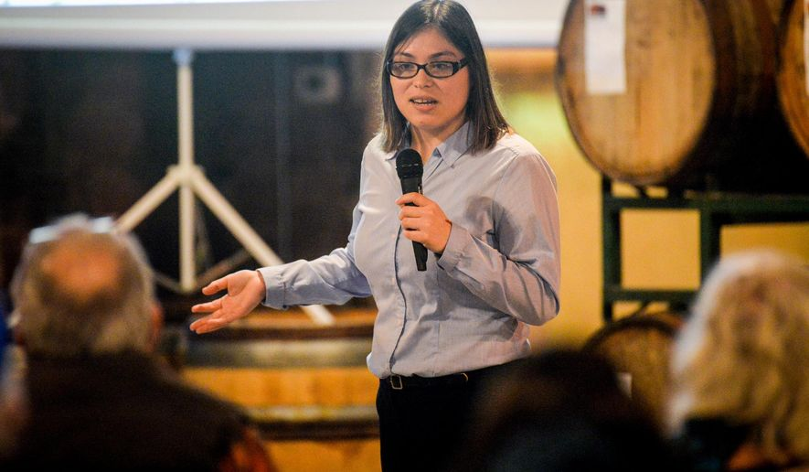 """ADVANCE FOR WEEKEND EDITIONS, JAN. 30-31 - In this photo taken Thursday, Jan. 21, 2016, Nancy Fernandez, a climate change intern with the Lewis and Clark National Historical Park, discusses plant responses to climate change during the """"Nature Matters"""" talk at the Fort George Brewery in Astoria, Ore.. (Joshua Bessex/The Daily Astorian via AP) MANDATORY CREDIT"""