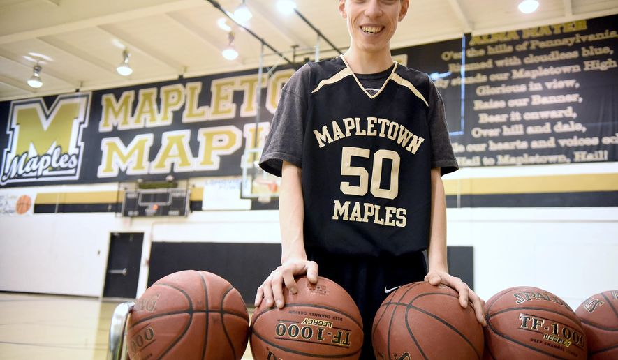 Austin Herpak is photographed at Mapletown High School gym on Jan. 13, 2016 in Greensboro, Pa.  Herpak is autistic and faces many challenges, but you'll rarely find him without a smile on his face or bringing them to the faces of those around him. In a recent game against Monessen, the Monessen players stood back several times and let Herpak score 12 points for his team.   (Katie Roupe/Observer-Reporter via AP) MANDATORY CREDIT