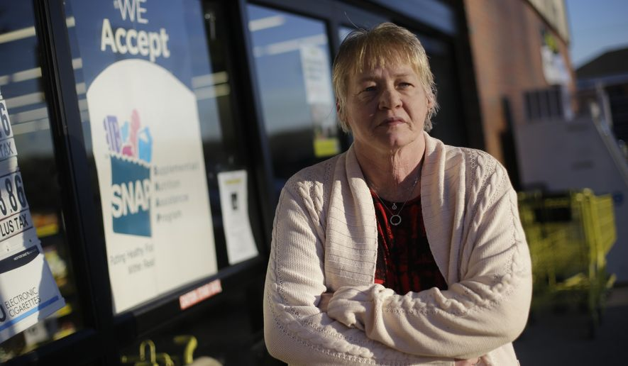 In this Jan. 29, 2016 photo, Terry Work stands outside a store that accepts food stamps in Bon Aqua, Tenn. Work's 27-year-old deaf son recently was denied disability payments, meaning he is considered able-bodied. And that means he stands to lose his food stamps, even though she said her son has trouble keeping a job because of his deafness. More than 1 million low-income residents in 21 states could soon lose their government food stamps if they fail to meet work requirements that began kicking in this month. (AP Photo/Mark Humphrey)