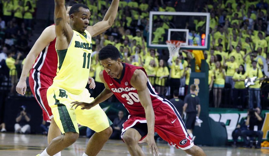 Georgia guard J.J. Frazier (30) drives on Baylor guard Lester Medford (11) in the first half of an NCAA college basketball game, Saturday, Jan. 30, 2016, in Waco, Texas. (Rod Aydelotte/Waco Tribune Herald, via AP)