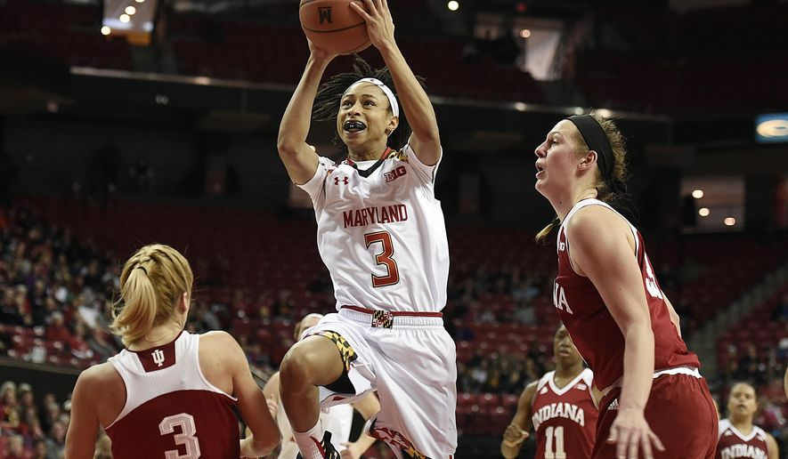 Maryland's Brene Moseley, center, shoots between Indiana's Tyra Buss, left and Amanda Cahill in the first half of an NCAA college basketball game, Saturday, Jan. 30, 2016, in College Park, Md. (AP Photo/Gail Burton)