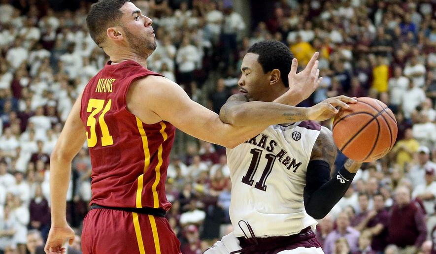 Iowa State's Georges Niang (31) fouls Texas A&M's Anthony Collins (11) to foul out of an NCAA college basketball game during the second half Saturday, Jan. 30, 2016, in College Station, Texas. Texas A&M won 72-62. (AP Photo/Sam Craft)