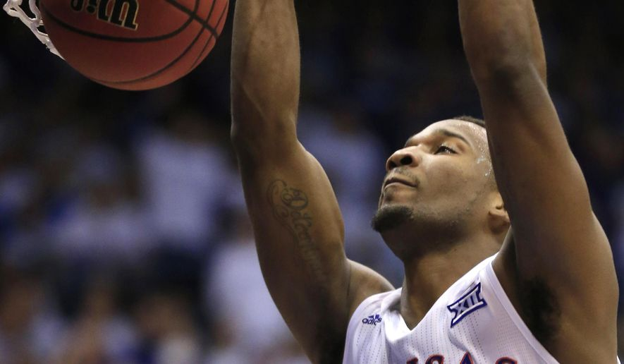 Kansas guard Wayne Selden Jr. (1) dunks during the first half of an NCAA college basketball game against Kentucky in Lawrence, Kan., Saturday, Jan. 30, 2016. (AP Photo/Orlin Wagner)