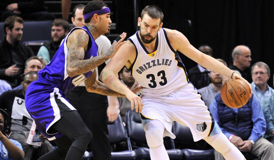 Memphis Grizzlies center Marc Gasol (33) controls the ball against Sacramento Kings center Willie Cauley-Stein (00) in the first half of an NBA basketball game Saturday, Jan. 30, 2016, in Memphis, Tenn. (AP Photo/Brandon Dill)