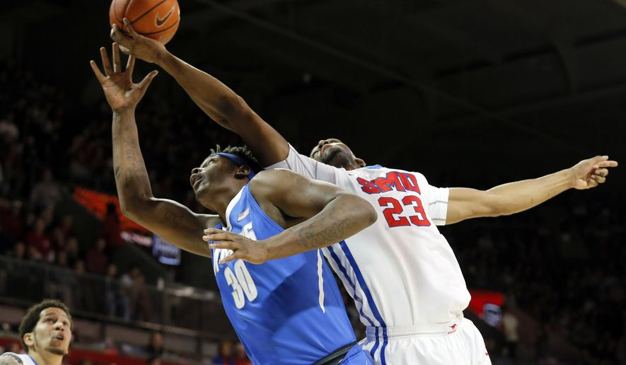 SMU's Nic Moore, bottom left, watches as forward Jordan Tolbert (23) collects a defensive rebound over Memphis forward Nick Marshall (30) during the first half of an NCAA college basketball game Saturday, Jan. 30, 2016, in Dallas. (AP Photo/Tony Gutierrez)