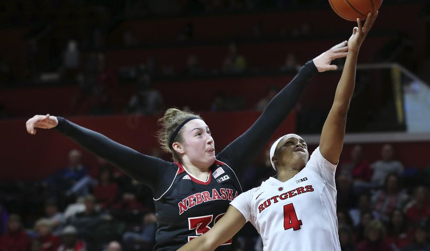Nebraska forward Jessica Shepard (32) tries to block a shot by Rutgers guard Briyona Canty (4) during the second half of an NCAA college basketball game Saturday, Jan. 30, 2016, in Piscataway, N.J. Rutgers won 66-56. (AP Photo/Mel Evans)