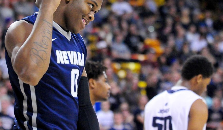 Nevada's Cameron Oliver flexes after blocking a shot during an NCAA college basketball game against Utah State, Saturday, Jan. 30, 2016, in Logan, Utah. (John Zsiray/Herald Journal via AP) MANDATORY CREDIT