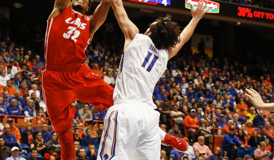 New Mexico's Tim Williams (32) shoots over Boise State's Zach Haney (11) during the first half of an NCAA college basketball game in Boise, Idaho, on Saturday, Jan. 30, 2016. (AP Photo/Otto Kitsinger)