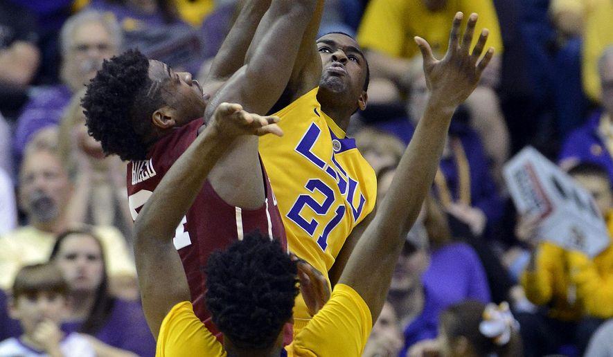LSU forward Aaron Epps (21) blocks the shot of Oklahoma guard Buddy Hield (24) as LSU guard Antonio Blakeney (2) applies pressure in the first half of an NCAA college basketball game in Baton Rouge, La., Saturday, Jan. 30, 2016. (AP Photo/Bill Feig)