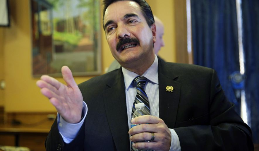 FILE - In this Wednesday, Jan. 20, 2016 file photo, New Jersey Assembly Speaker Vincent Prieto, D-Secaucus, N.J., answers a question after he announced that lawmakers will focus on rolling back poverty in the state in the new legislative session, at the the Statehouse in Trenton, N.J. Prieto pointed to a study by Legal Services of New Jersey that calculated there are 2.8 million residents in poverty in the state as the impetus for the effort. (AP Photo/Mel Evans,file)