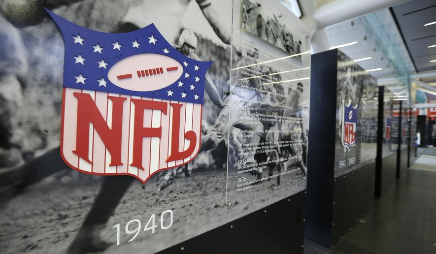 A row of display panels chronicle the history of the National Football League at the NFL Experience during a preview tour of Super Bowl 50 official fan attractions Friday, Jan. 29, 2016, in San Francisco. The attractions open on Saturday. (AP Photo/Eric Risberg)