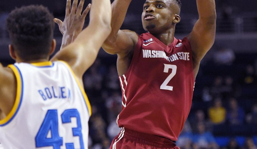 Washington State guard Ike Iroegbu, right, shoots as UCLA guard Jonah Bolden defends during the first half of an NCAA college basketball game, Saturday, Jan. 30, 2016, in Los Angeles. (AP Photo/Mark J. Terrill)