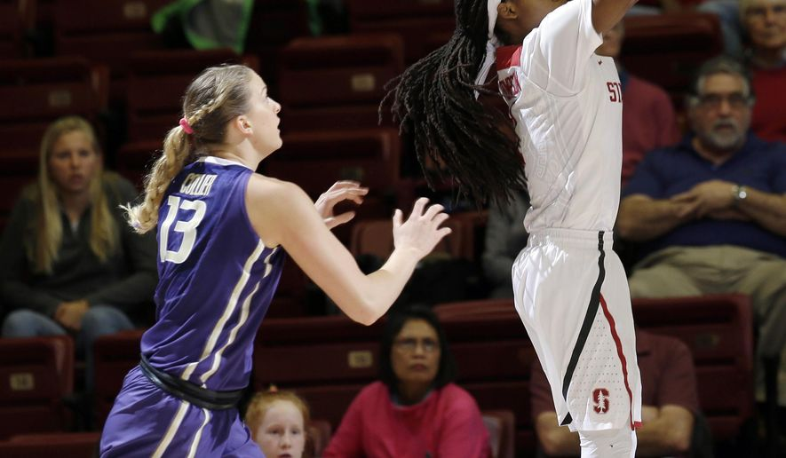 Stanford guard Lili Thompson, right, shoots in front of Washington forward Katie Collier during the first half of an NCAA college basketball game Friday, Jan. 29, 2016, in Stanford, Calif. (AP Photo/Marcio Jose Sanchez)
