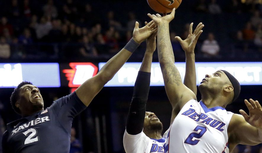 Xavier forward James Farr, left, battles for a rebound against DePaul center Tommy Hamilton IV, right, and forward Myke Henry during the first half of an NCAA college basketball game Saturday, Jan. 30, 2016, in Rosemont, Ill. (AP Photo/Nam Y. Huh)