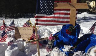 """A makeshift roadside memorial for rancher Robert """"LaVoy"""" Finicum stands on a highway north of Burns, Oregon. Mr. Finicum was killed Tuesday in a confrontation with the FBI and Oregon State Police. Four people occupying the Malheur National Wildlife Refuge held their position Sunday. (Associated Press)"""