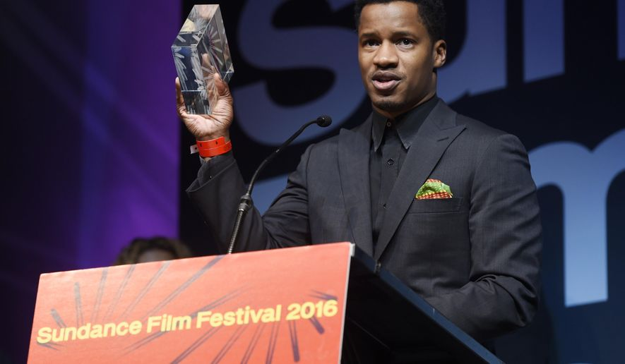 "Nate Parker, the star, director and producer of ""The Birth of a Nation,"" holds aloft the U.S. Dramatic Audience Award for the film during the 2016 Sundance Film Festival Awards Ceremony on Saturday, Jan. 30, 2016, in Park City, Utah. The film also won the U.S. Grand Jury Prize: Dramatic award. (Photo by Chris Pizzello/Invision/AP)"