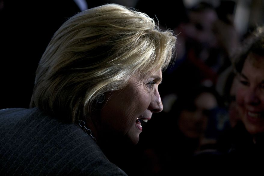 Democratic presidential candidate Hillary Clinton greets members of the audience at a rally at Abraham Lincoln High School in Council Bluffs, Iowa, Sunday, Jan. 31, 2016. (AP Photo/Andrew Harnik)
