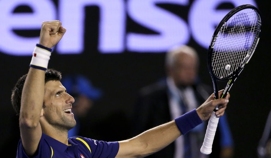 Novak Djokovic of Serbia celebrates after defeating Andy Murray of Britain in the men's singles final at the Australian Open tennis championships in Melbourne, Australia, Sunday, Jan. 31, 2016.(AP Photo/Rick Rycroft)