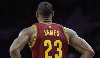 Cleveland Cavaliers forward LeBron James is seen during the second half of an NBA basketball game against the Detroit Pistons, Friday, Jan. 29, 2016 in Auburn Hills, Mich. (AP Photo/Carlos Osorio)