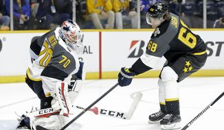 Metropolitan Division goalie Braden Holtby (70), of the Washington Capitals, blocks a shot by Atlantic Division forward Jaromir Jagr (68), of the Florida Panthers, during an NHL hockey All-Star semifinal round game Sunday, Jan. 31, 2016, in Nashville, Tenn. (AP Photo/Mark Humphrey)