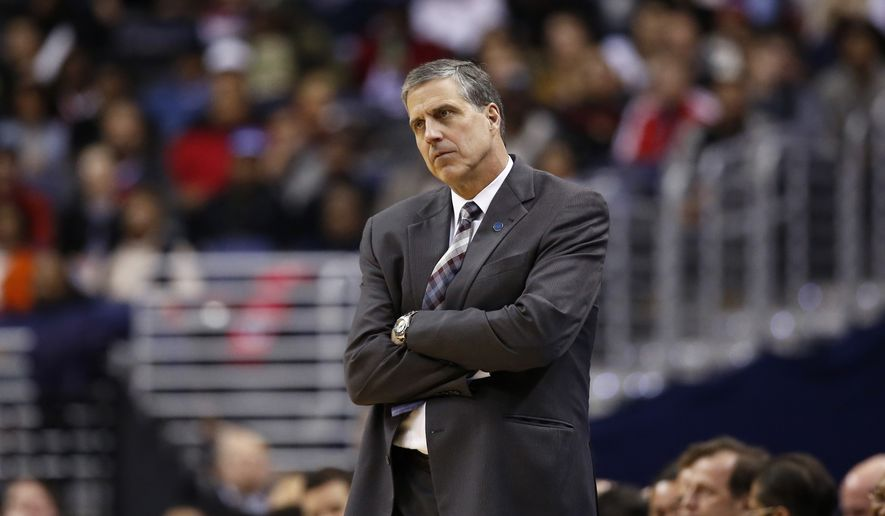 Washington Wizards head coach Randy Wittman reacts in the first half of an NBA basketball game against the Miami Heat, Wednesday, Jan. 20, 2016, in Washington. (AP Photo/Alex Brandon)