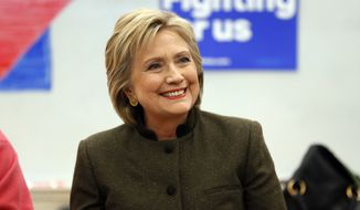 Democratic presidential candidate Hillary Clinton smiles during a campaign event at Berg Middle School, Thursday, Jan. 28, 2016 in Newton, Iowa. (AP Photo/Paul Sancya)