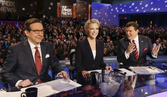 FOX News debate moderators (L-R) Chris Wallace, Megyn Kelly and Bret Baier wait for the start of the Republican presidential primary debate, Thursday, Jan. 28, 2016, in Des Moines, Iowa. (AP Photo/Charlie Neibergall) ** FILE **