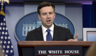 White House press secretary Josh Earnest speaks during the daily news briefing at the White House in Washington, Thursday, Jan. 28, 2016. Earnest discussed the Flint, Mich. water emergency and other topics. (AP Photo/Carolyn Kaster)