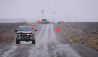 A law enforcement vehicle heads away from a roadblock near the Malheur National Wildlife Refuge in Harney County, Ore., Jan. 28, 2016. (Beth Nakamura/The Oregonian via AP) MANDATORY CREDIT