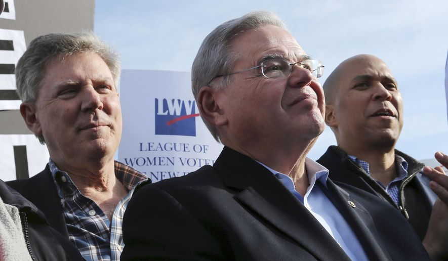 Democratic Rep. Frank Pallone Jr., left, Democratic U.S. Senators Bob Menendez,  center, and Cory Booker, right, listen as a speaker addresses a large rally on the Asbury Park boardwalk opposing federal plans that would allow oil and gas drilling in the Atlantic Ocean, Sunday, Jan. 31, 2016, in Asbury Park, N.J. The three Democrats called on the Obama administration to end its plans to allow oil production off the coast of Virginia, the Carolinas and Georgia. (AP Photo/Mel Evans)