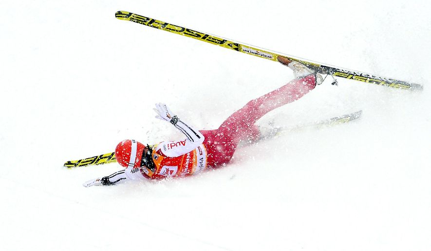 Germany's Eric Frenzel crashes during his first jump of the Nordic Combined World Cup competition in Seefeld, Austria, Sunday, Jan. 31, 2016. (AP Photo/Kerstin Joensson)