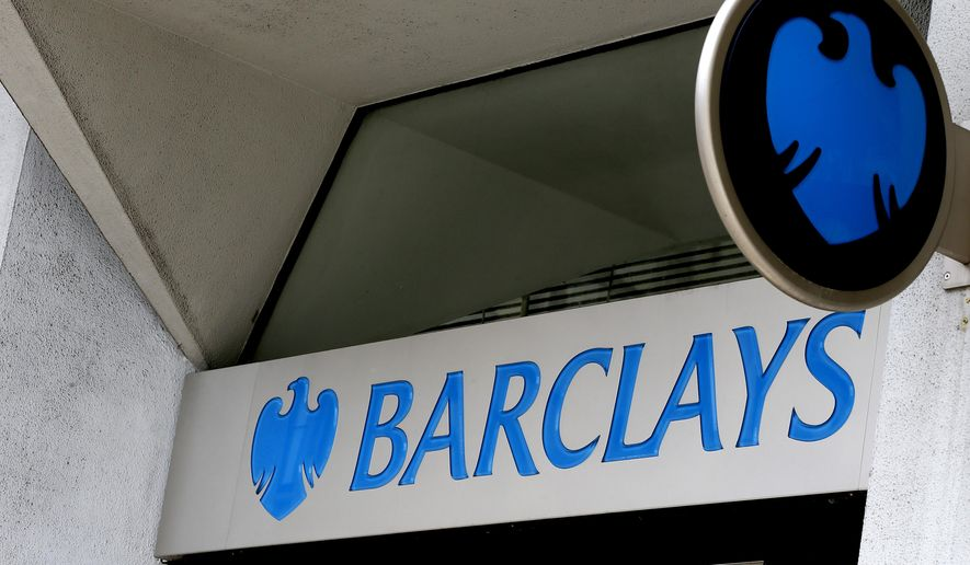 "FILE - A July 29, 2015 file photo shows the sign on a branch of Barclays Bank in London.  The Securities and Exchange Commission said Sunday, Jan. 31, 2016, that two major global banks, Barclays and Credit Suisse, will pay a combined $154.3 million to settle state and federal investigations that they misled clients about the safety of trading on their ""dark pool"" financial exchanges.  (AP Photo/Kirsty Wigglesworth, File)"