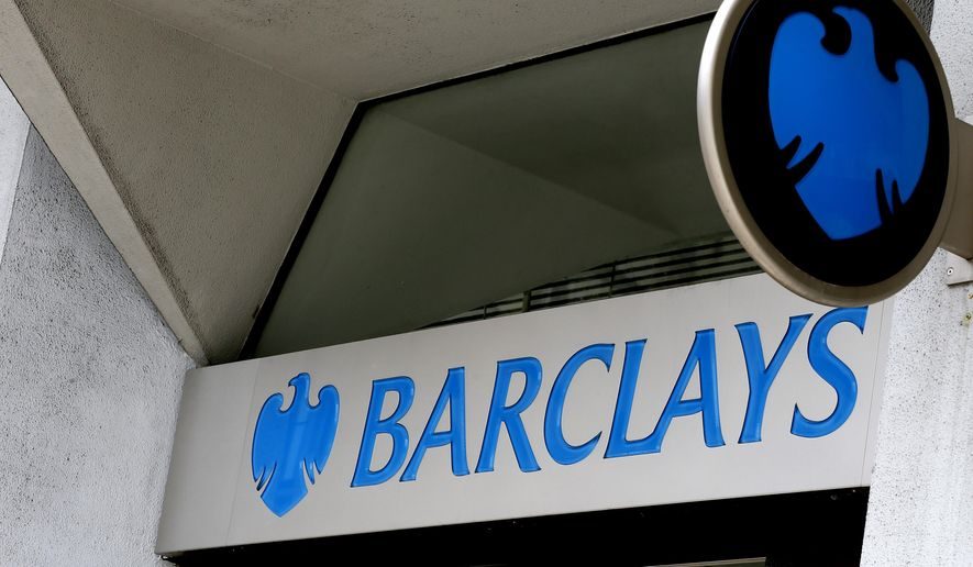 A sign on a branch of Barclays Bank in London is seen here on July 29, 2015. (Associated Press) **FILE**