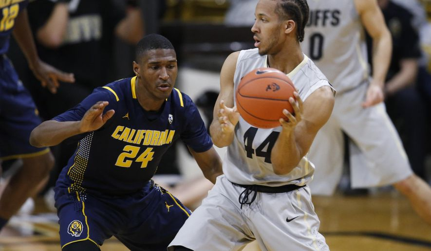 Colorado guard Josh Fortune, right, passes the ball as California guard Jordan Mathews defends in the first half of an NCAA college basketball game in Boulder, Colo., Sunday, Jan. 31, 2016. (AP Photo/David Zalubowski)