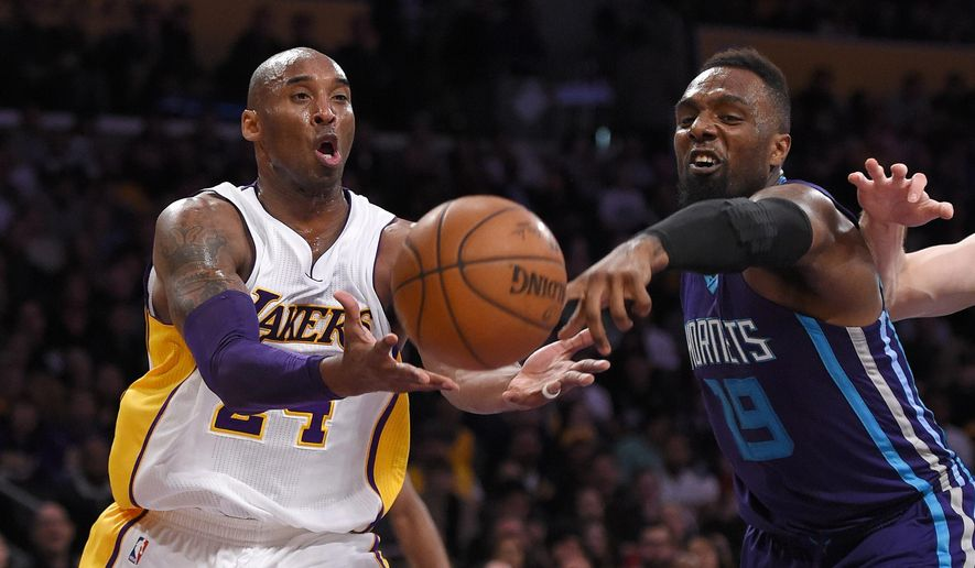 Los Angeles Lakers forward Kobe Bryant, left, and Charlotte Hornets forward P.J. Hairston reach for a loose ball during the first half of an NBA basketball game, Sunday, Jan. 31, 2016, in Los Angeles. (AP Photo/Mark J. Terrill)