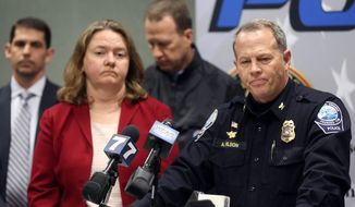 Montgomery County Commonwealth's Attorney Mary Pettitt, left, and Blacksburg Police Chief Anthony Wilson listen to questions during a news conference Saturday, Jan. 30, 2016, in Blacksburg Va. Virginia Tech student, David Eisenhauer, has been charged with first-degree murder in the death of Nicole Madison Lovell, whose remains were found in North Carolina. (Matt Gentry/The Roanoke Times via AP)