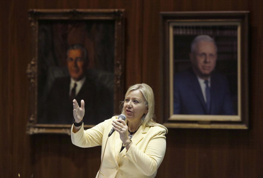 FILE - In this April 17, 2014, file photo, Rep. Debbie Lesko, R-Peoria, answers questions about an amendment to a bill at the Arizona Capitol in Phoenix. A major overhaul of the state's badly underfunded pension plan for public safety workers is expected to be introduced in the Arizona Senate on Monday, Feb. 1, 2016. Lesko will introduce the bill. (AP Photo/Ross D. Franklin, File)