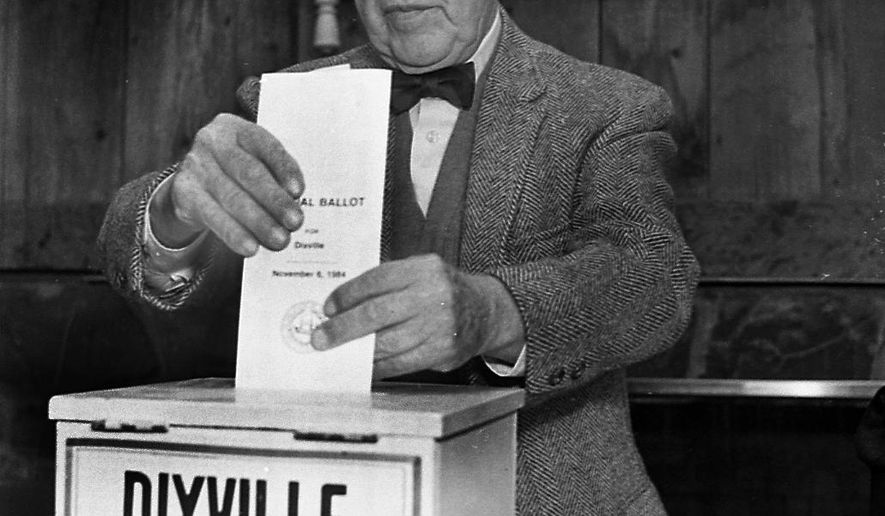 FILE - In this Feb. 28, 1984, file photo, Neil Tillotson gets ready to cast the first ballot in the New Hampshire presidential primary in Dixville, N.H. In Dixville, one of three tiny northern towns where voters will cast ballots just after midnight Feb. 9, no one quite knows how the early voting tradition started. But most agree it had something to do with rival photographers. (AP Photo/Jim Cole, File)