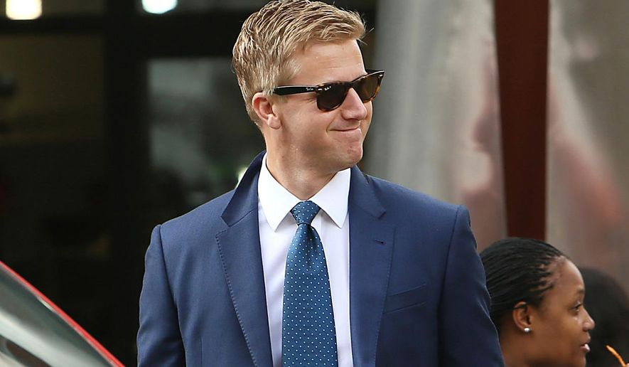 In this photo taken Tuesday, Jan. 26, 2016 South African Idols judge Gareth Cliff, is photographed outside the High Court in Johannesburg. The local television network M-Net dropped Cliff from its judging panel for the reality singing competition after a tweet that some South Africans thought was racist. Cliff, who said his tweet was not racist and was instead a defence of free speech, then won a court case against M-Net and was reinstated on Idols South Africa. (AP Photo)