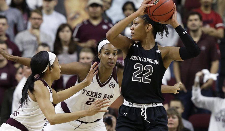 South Carolina's A'ja Wilson (22) is double-teamed by Texas A&M's Chelsea Jennings, left, and Rachel Mitchell during the first half of an NCAA college basketball game Sunday, Jan. 31, 2016, in College Station, Texas. (AP Photo/Pat Sullivan)