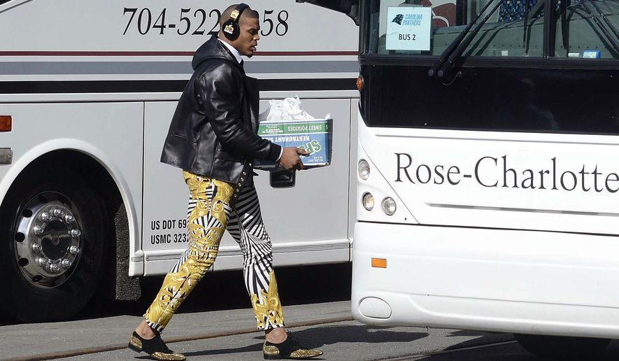 Carolina Panthers quarterback Cam Newton sports zebra-stripe pants as he moves to board a bus on his way to the airport to head to San Francisco for Super Bowl 50 against the Denver Broncos, Sunday, Jan. 31, 2016, in Charlotte, N.C. (Robert Lahser/The Charlotte Observer via AP) MAGAZINES OUT; TV OUT; MANDATORY CREDIT