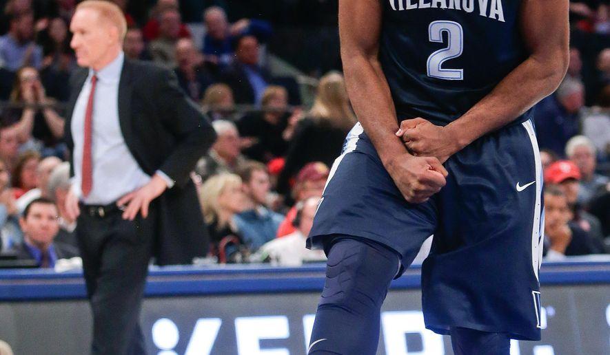 Villanova's Kris Jenkins (2) celebrates as St. John's head coach Chris Mullin, left, reacts during the first half of an NCAA college basketball game Sunday, Jan. 31, 2016, in New York. (AP Photo/Frank Franklin II)