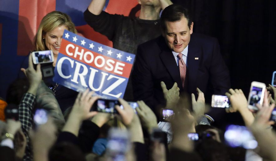 """At a victory party at the Iowa State Fair in Des Moines, Sen. Ted Cruz said his caucus win was a victory for """"courageous conservatives"""" and a blow to the Washington establishment. (Associated Press)"""