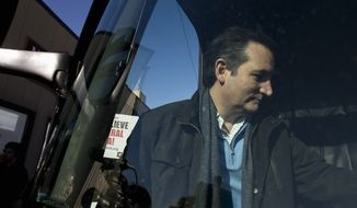 Republican presidential candidate, Sen. Ted Cruz, R-Texas gets on his campaign bus after a rally, Friday, Jan. 29, 2016, in Fenton, Iowa. (AP Photo/Jae C. Hong)