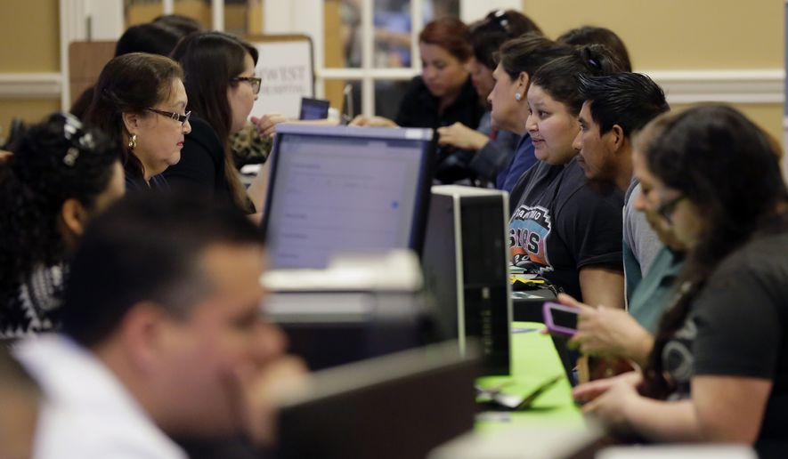 Affordable Care Act navigators help guide those looking for insurance during an enrollment event in San Antonio. (Associated Press)