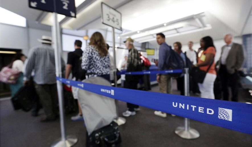 FILE - In this May 8, 2013, file photo, groups of passengers wait at a United Airlines gate to board a flight at O'Hare International Airport in Chicago. United Airlines, which was the only U.S. carrier not to let families board early, has reversed its 4-year-old policy. The move, which takes effect Feb. 15, 2016, lets families with children age 2 and under get settled in their seats before the rush of other passengers clamoring for overhead bin space. (AP Photo/M. Spencer Green, File)