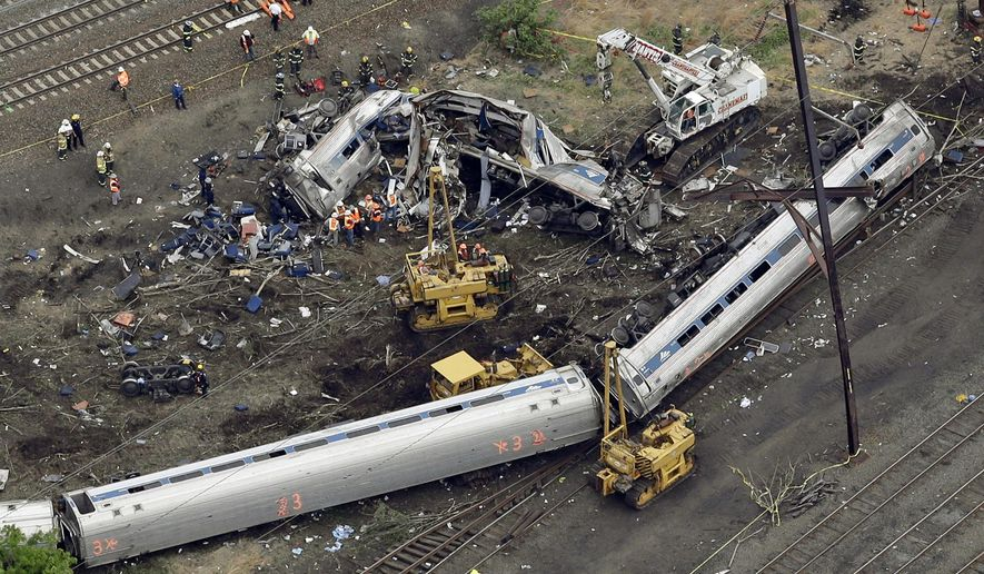 In this May 13, 2015, file photo, emergency personnel work at the scene of a derailment in Philadelphia of an Amtrak train headed to New York. A federal accident investigations board is set to release documents Feb. 1, 2016, that could shed light on the cause of a fatal Amtrak train derailment in Philadelphia last year. (AP Photo/Patrick Semansky, File)
