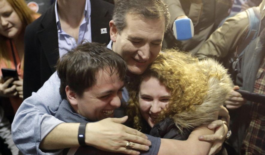 Republican presidential candidate, Sen. Ted Cruz, R-Texas, hugs Arden Jurskis and Kenzy Peach after Arden proposed Kenzy in front of Cruz at a campaign event at Iowa State Fairgrounds, Sunday, Jan. 31, 2016, in Des Moines, Iowa. Kenzy said yes. (AP Photo/Chris Carlson)